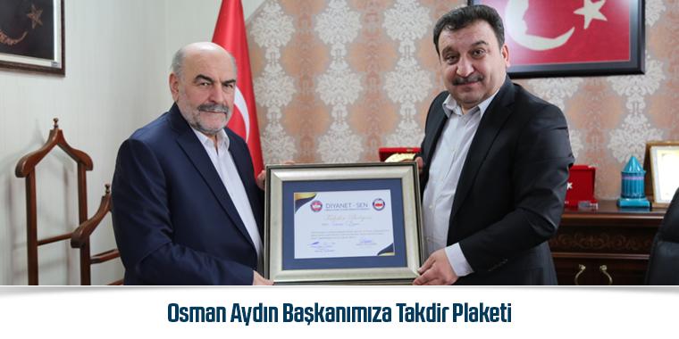 Osman Aydın Başkanımıza Takdir Plaketi